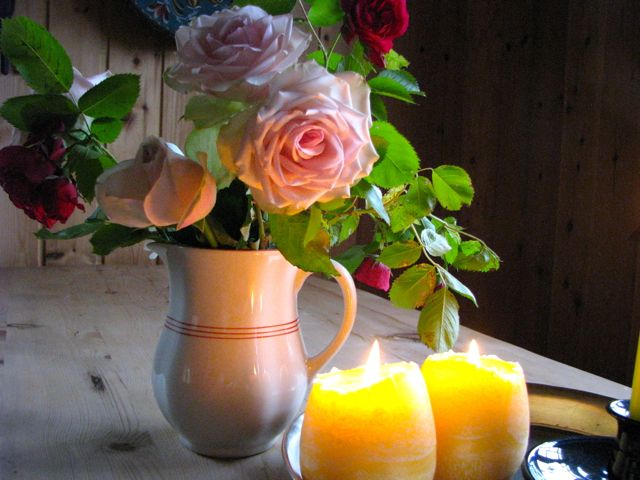 Roses in old pitcher